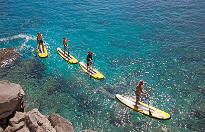 Surfing and Paddle Boarding Lessons